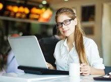 Girl in Coffee Shop with Laptop